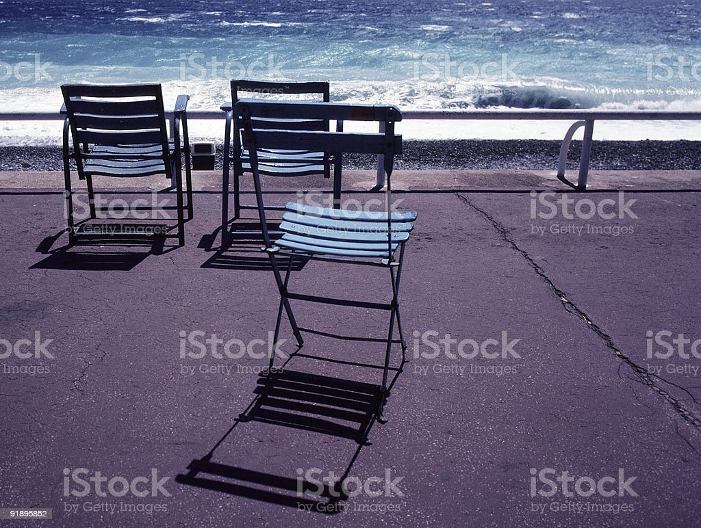 Three Deck Chairs, Nice, France royalty-free stock photo
