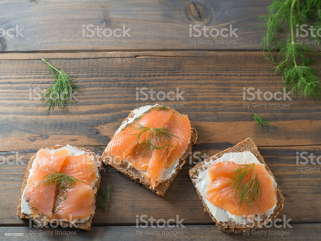 Three delicious sandwiches with smoked salmon with copy space stock photo