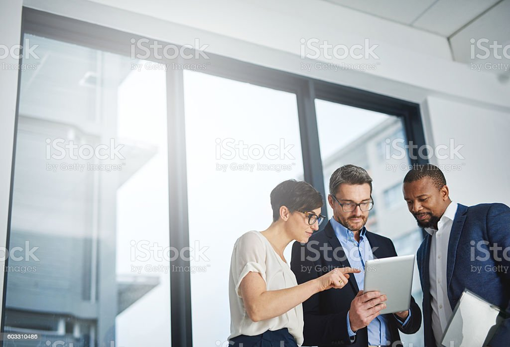 Three departments working towards one goal stock photo