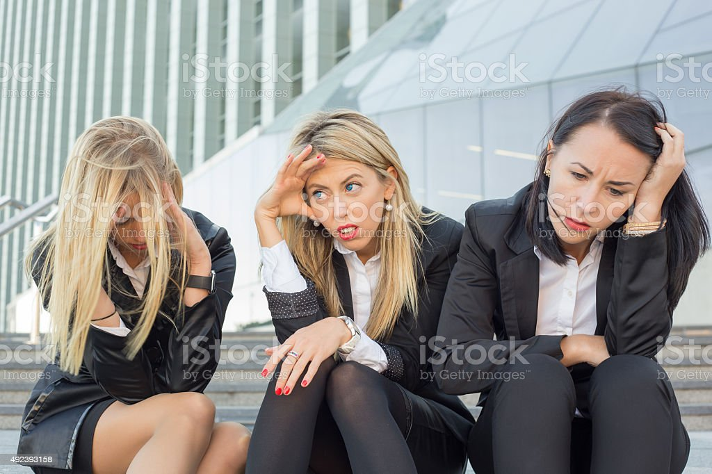 Three desperate business women stock photo
