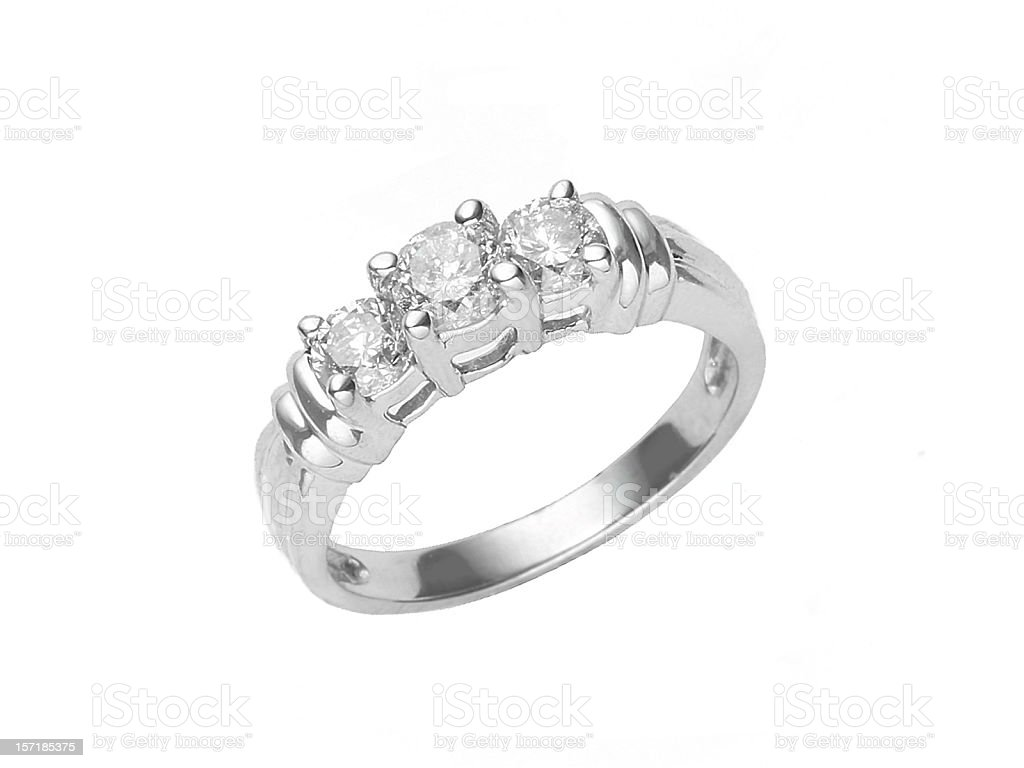 Three diamonds set in a white gold ring isolated on white stock photo