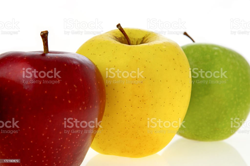 Three different apples lined up isolated on white royalty-free stock photo