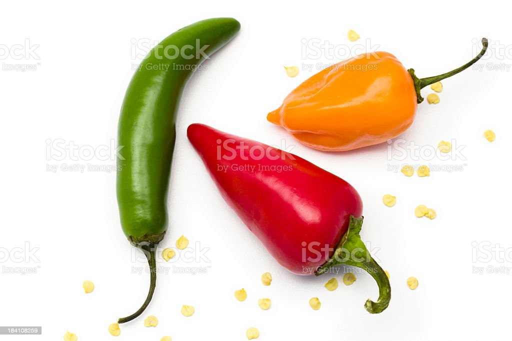 Three different colored and shaped peppers isolated on white royalty-free stock photo