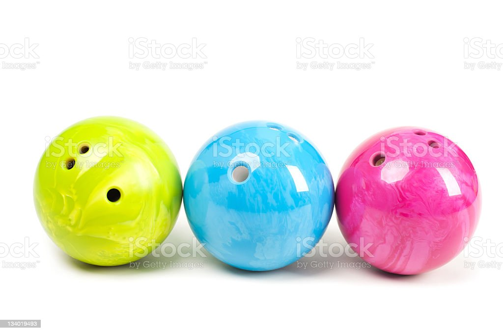 Three different colored bowling balls isolated on white stock photo