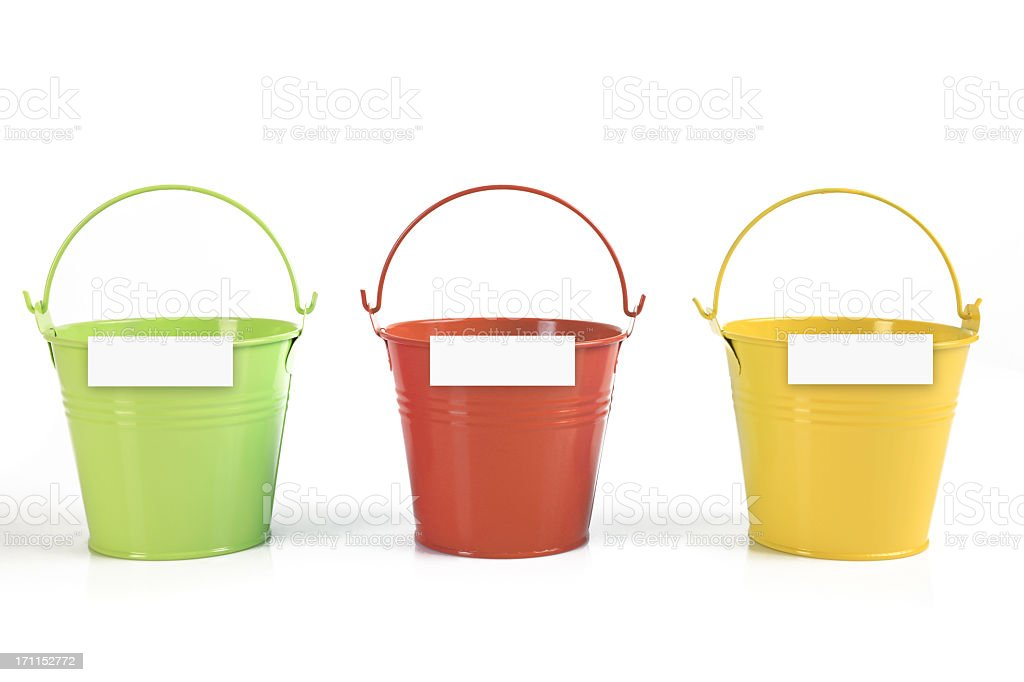 Three different colored buckets with handles stock photo