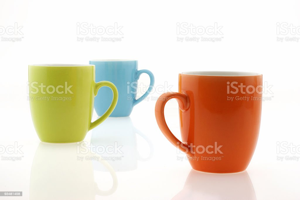 Three different colored plain coffee mugs royalty-free stock photo