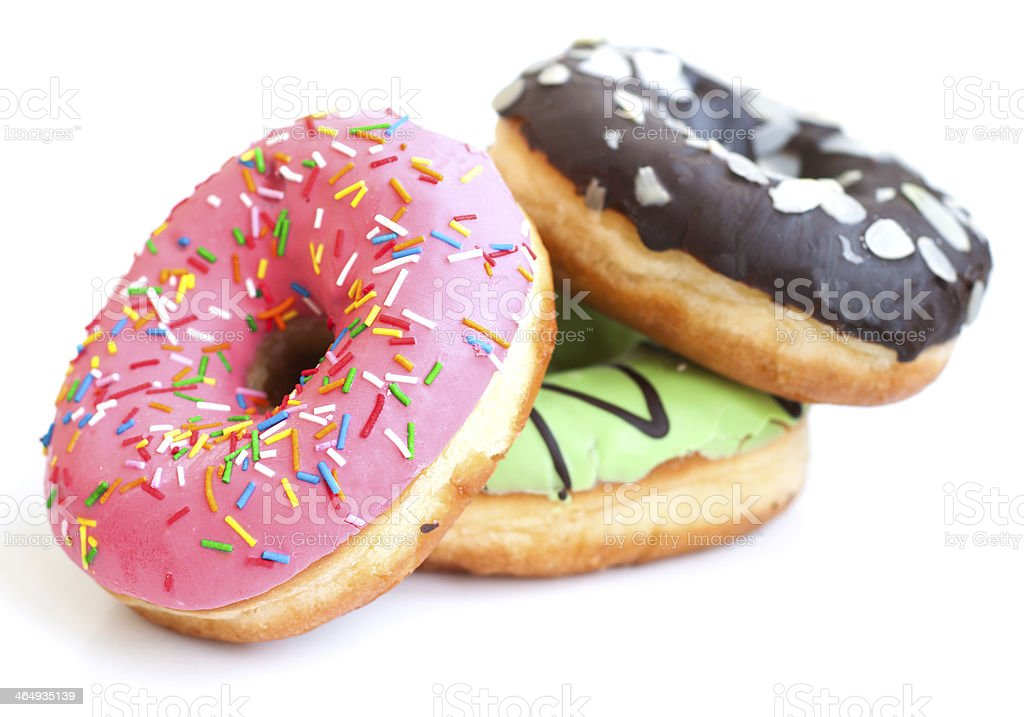 Three different colored types of donuts  stock photo
