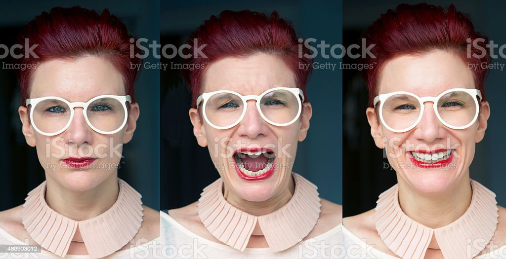 three different facial expressions of redhaired woman stock photo