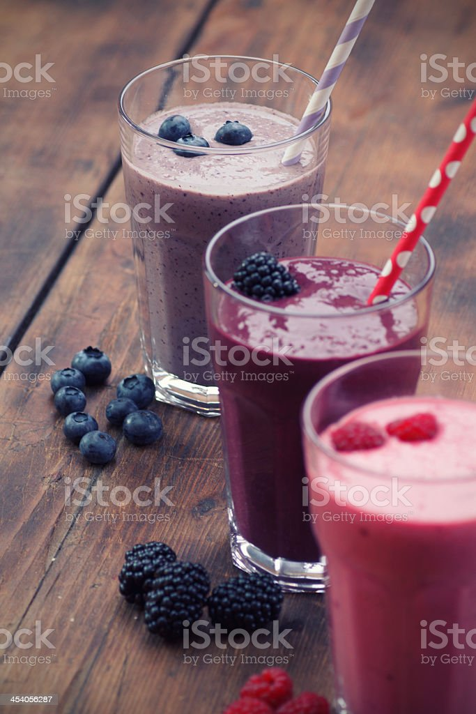 Three different fruit smoothies made from berries stock photo