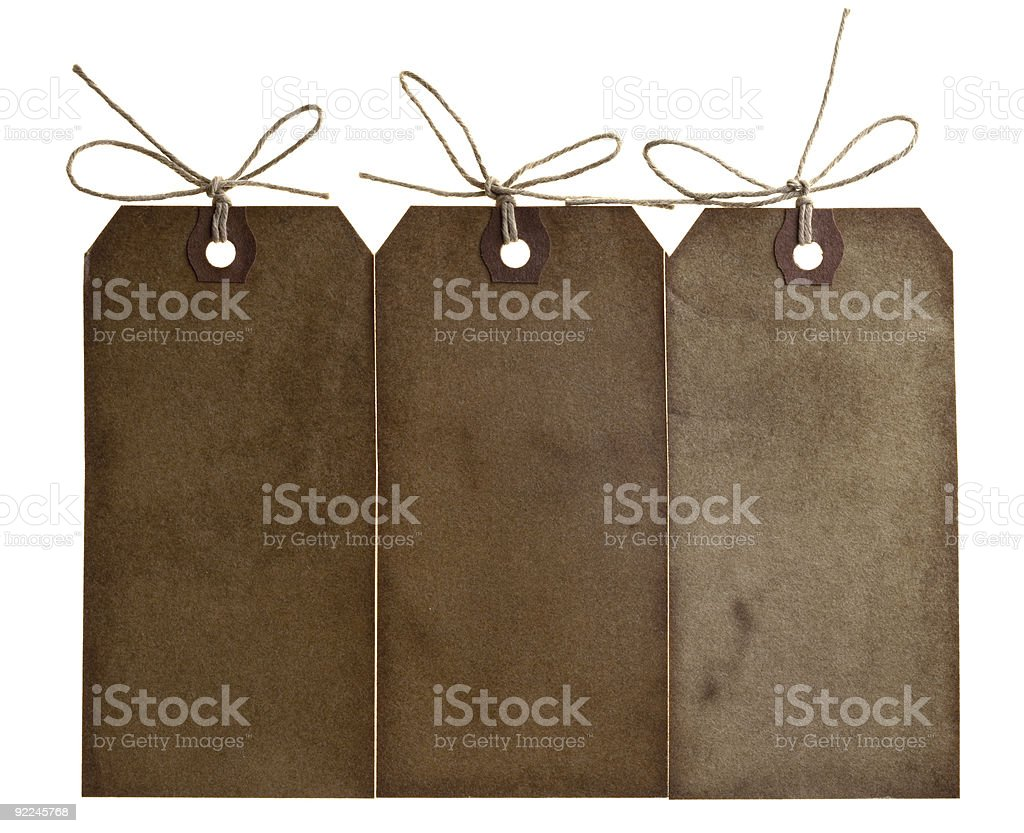 three different grunge paper tags with bow string isolated royalty-free stock photo