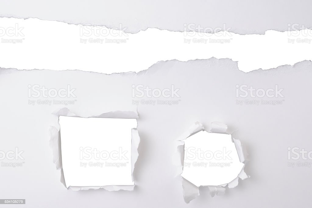 Three different holes in white paper on white background stock photo