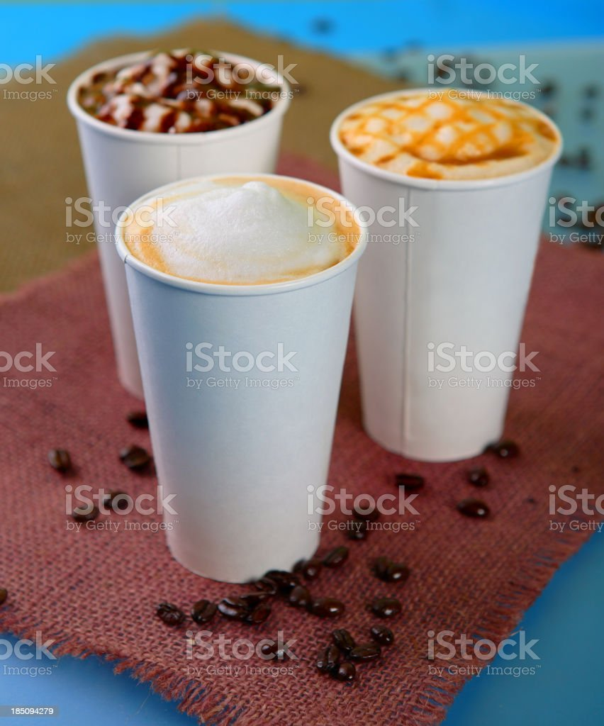 Three different lattes with coffee beans stock photo