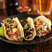 three different mexican street tacos