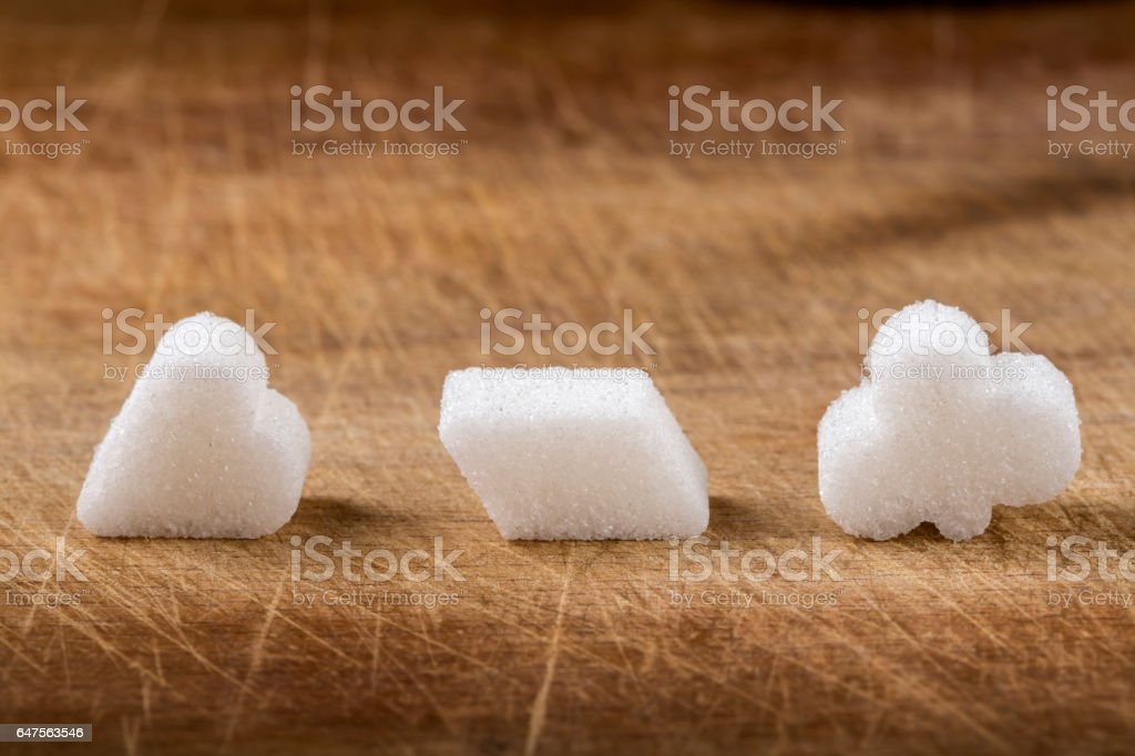 Three different sugar cubes on wood stock photo