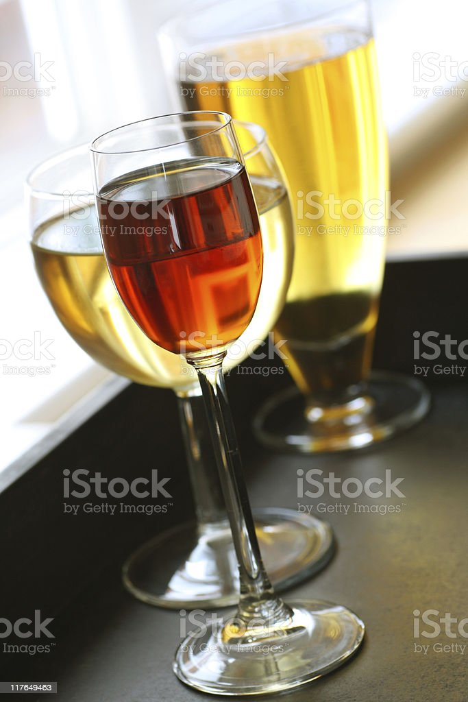 Three different types of glass with beverages inside stock photo