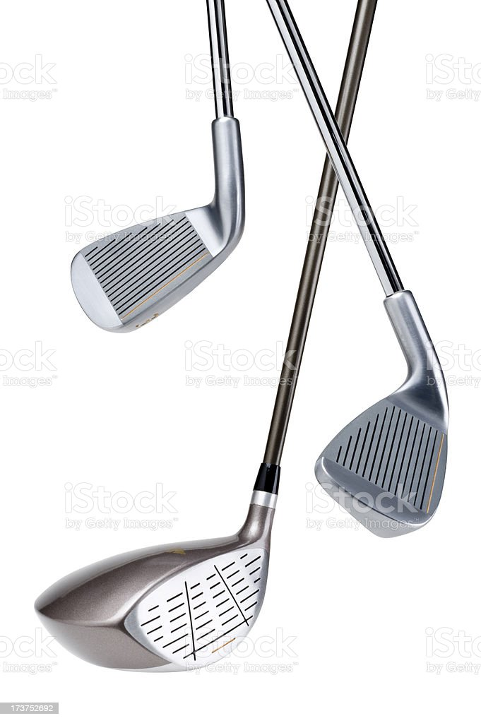 Three different types of golf clubs on a white background stock photo