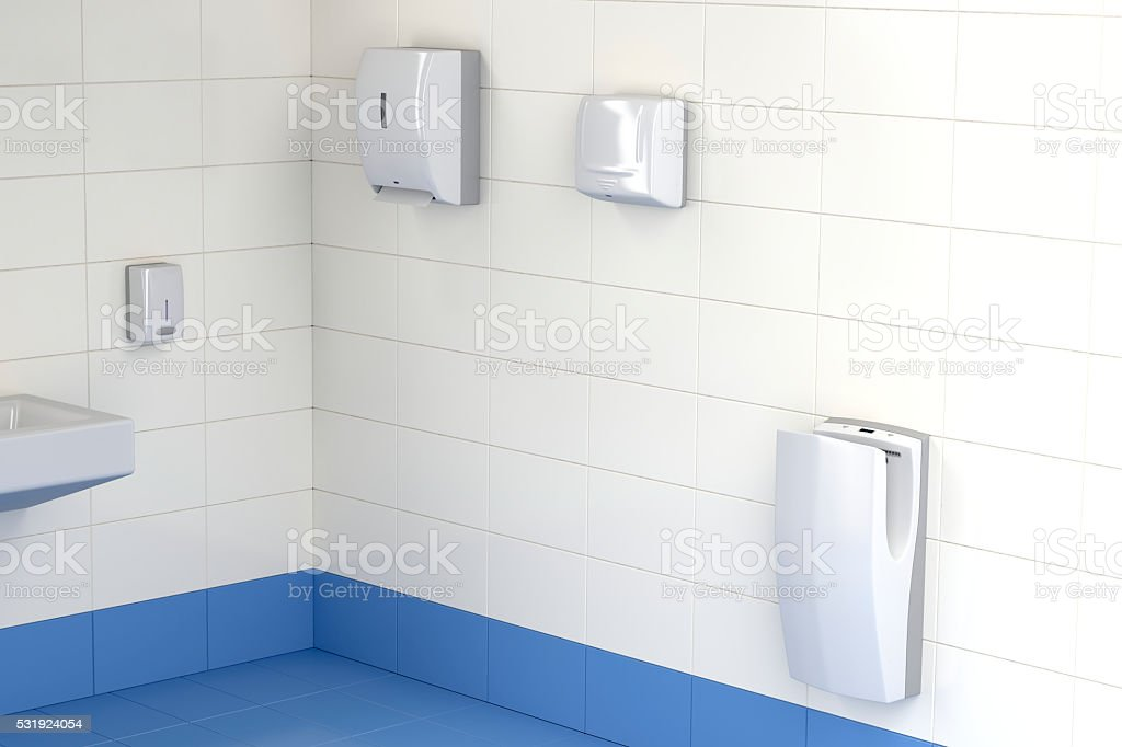 Three different types of hand dryers in the toilet stock photo
