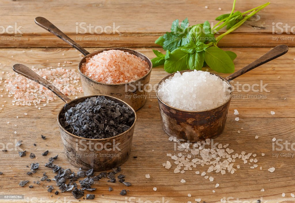 Three different types of salt in silver containers stock photo