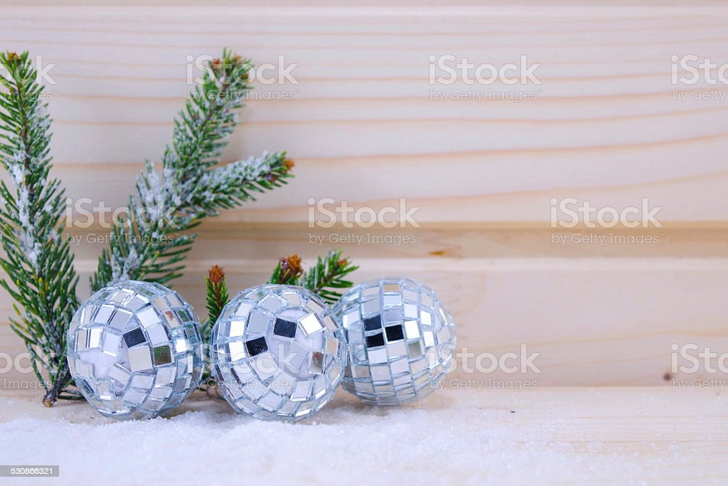 Three disco ball ornaments on a wooden surface royalty-free stock photo