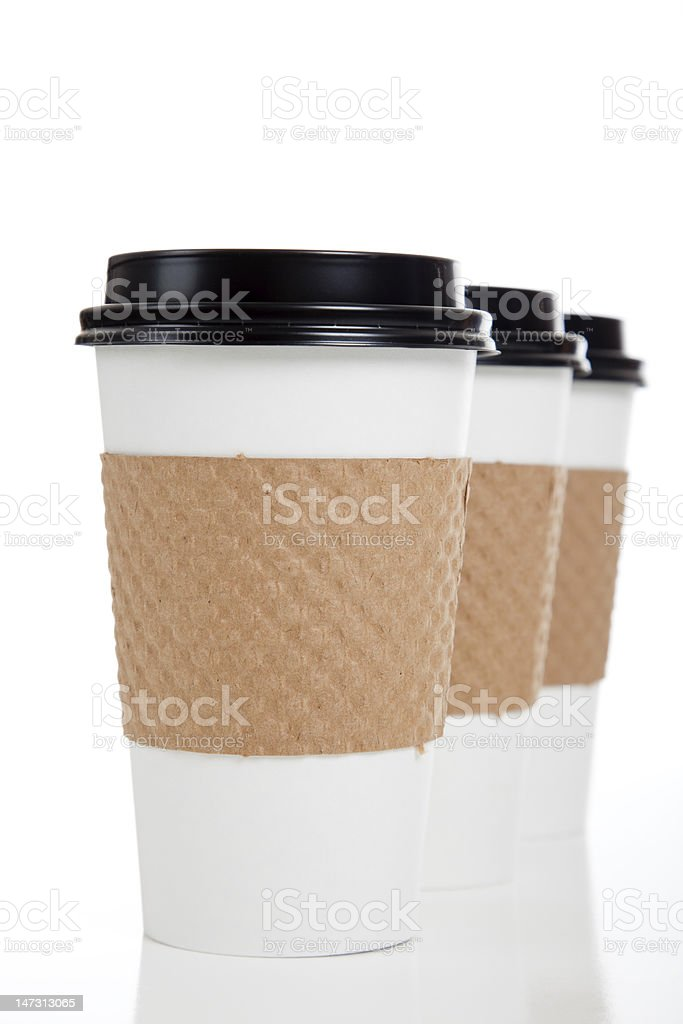 Three disposable paper coffee cups on white stock photo