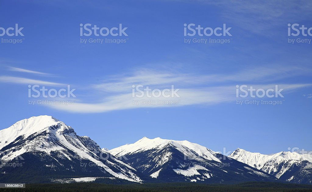 Three Distant Mountains With Snow. stock photo