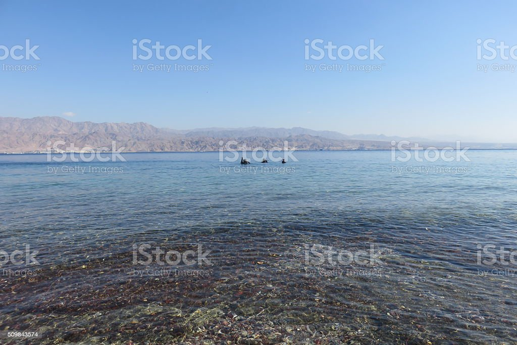 Three divers in the Red Sea stock photo
