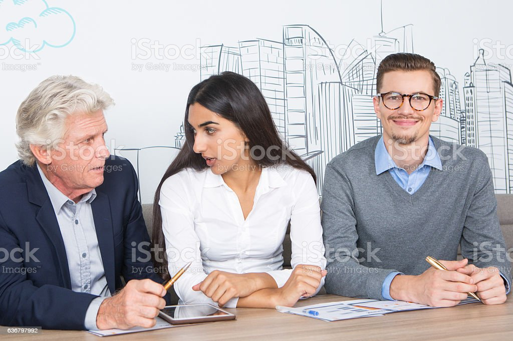 Three Diverse Content Colleagues Working in Cafe stock photo