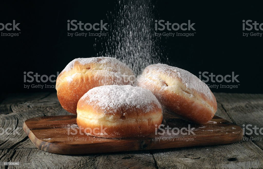 Three donut sprinkled with powdered sugar stock photo