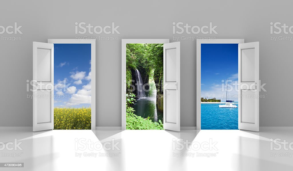 Three doors leading to different travel destinations stock photo