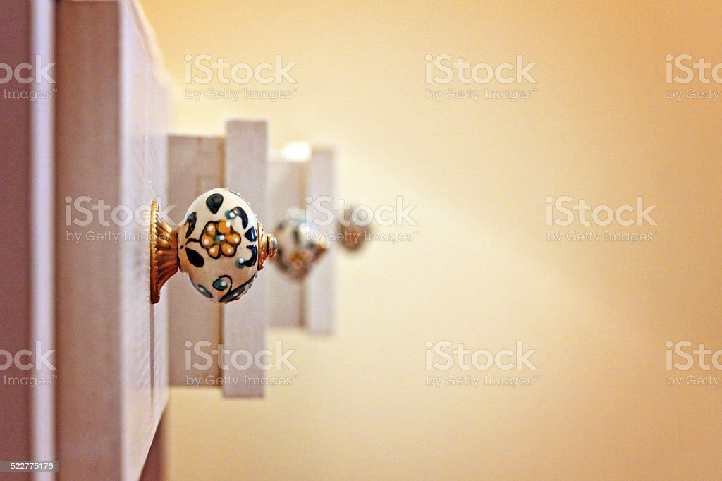 Three drawers with flowered knobs open at various lengths stock photo