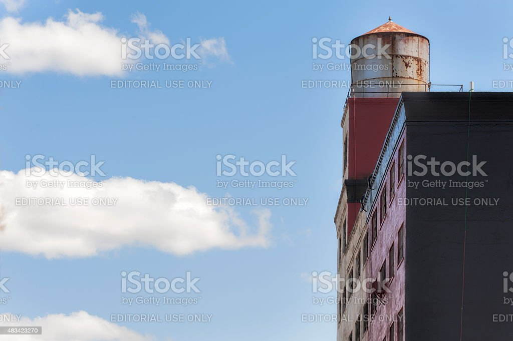 Three drifting clouds and a building stock photo