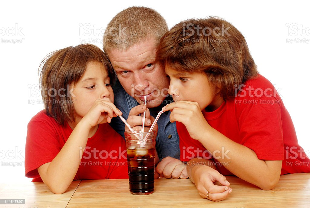Three Drinking Soda royalty-free stock photo