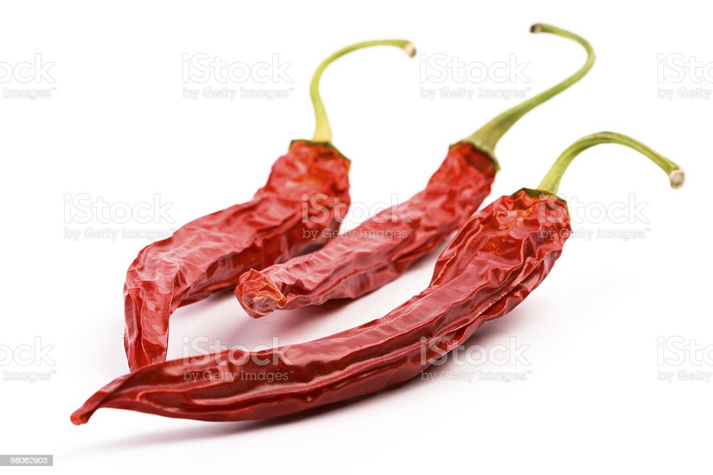 three dry red chili peppers stock photo