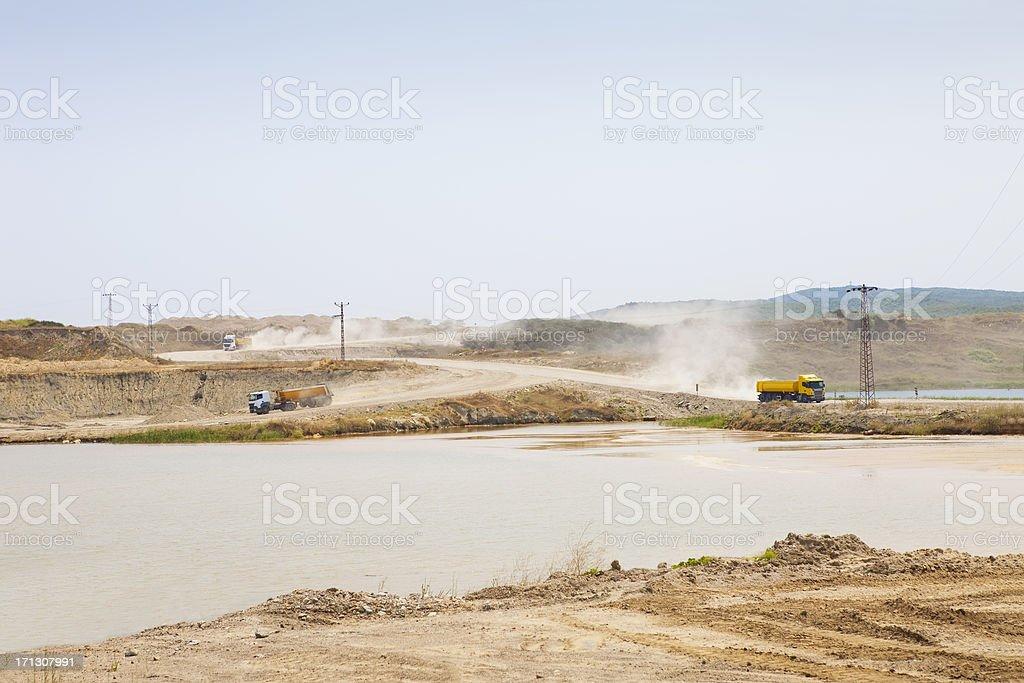 three dump trucks at sand mine royalty-free stock photo