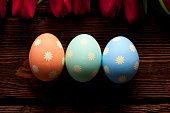 Three Easter eggs on wooden planks