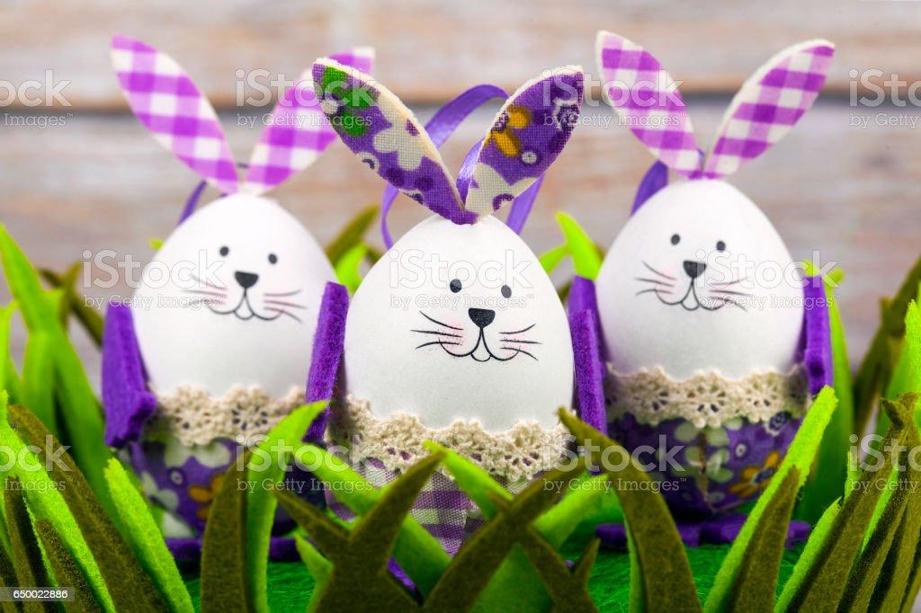 Three Easter rabbits eggs stock photo