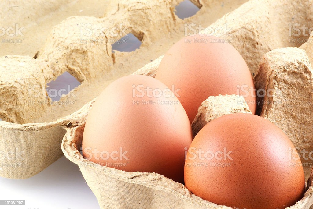 Three eggs in a box. stock photo