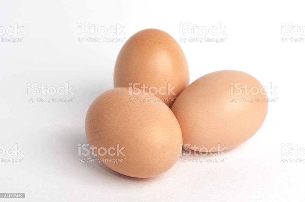 Three eggs on white background stock photo