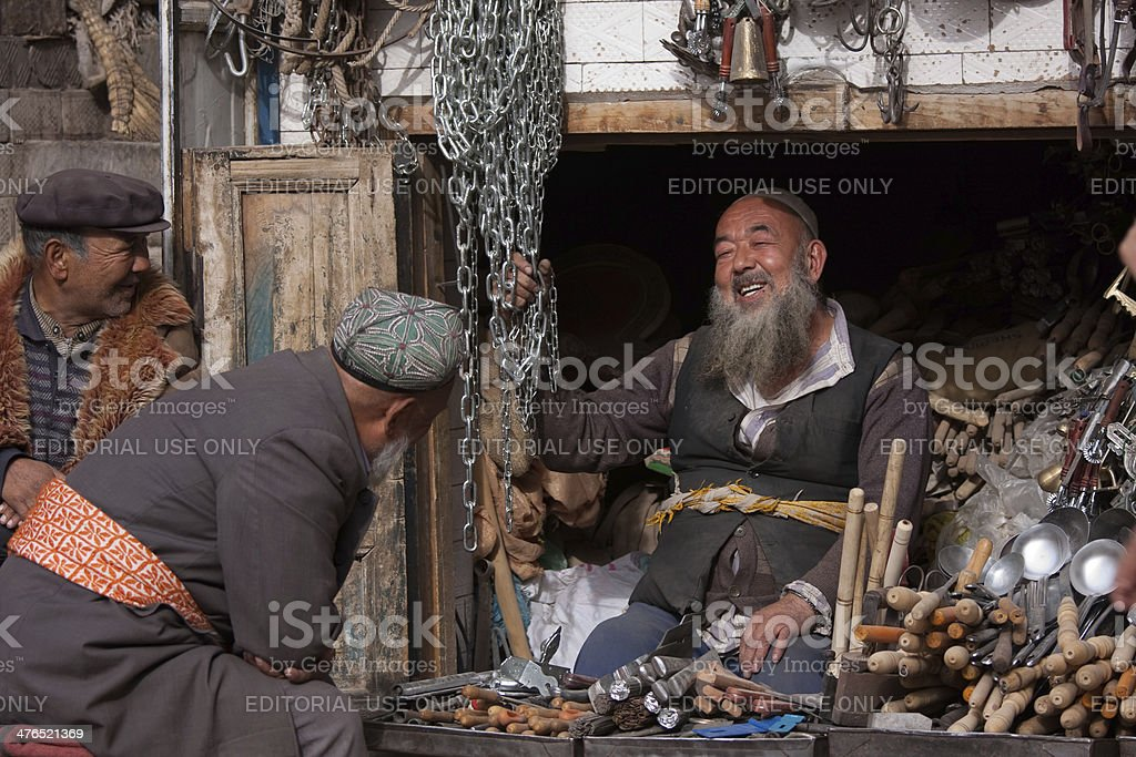 Three elderly Uyghur men sharing a laugh stock photo