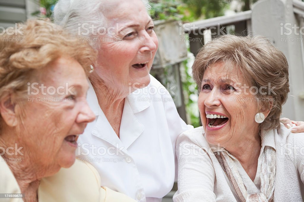 Three elderly women laughing royalty-free stock photo