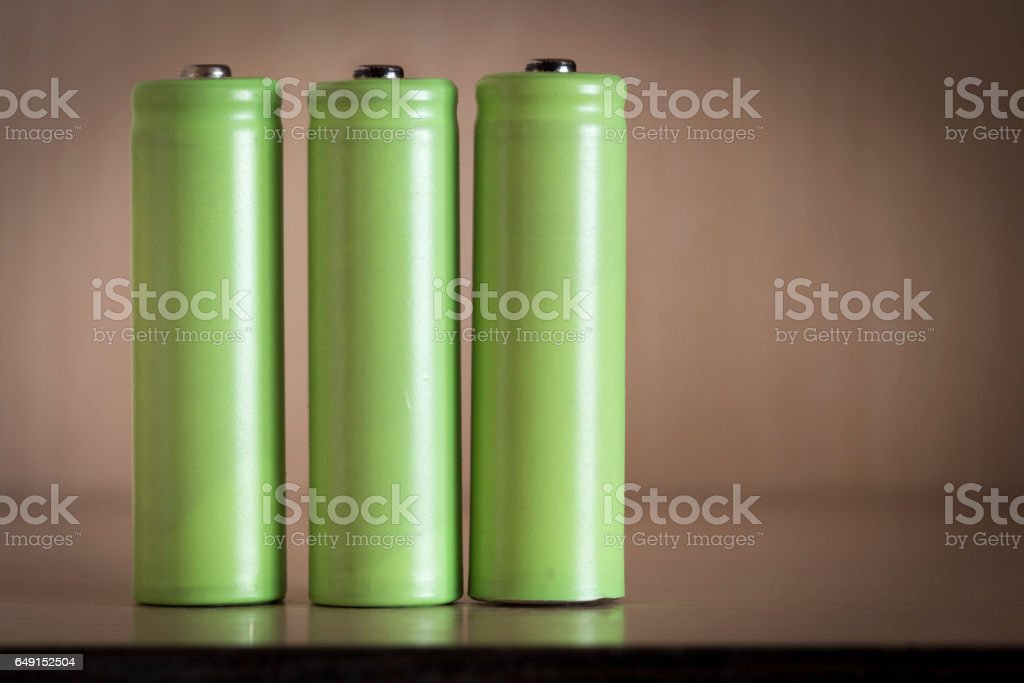 Three electric batteries stock photo