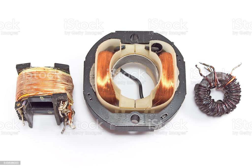 Three electric copper coil motors isolated on white stock photo