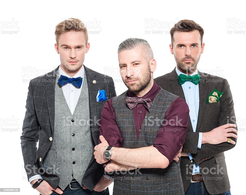 Three elegant businessmen in retro style outfit stock photo