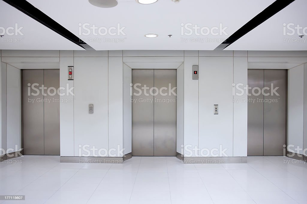 Three elevator doors in building stock photo