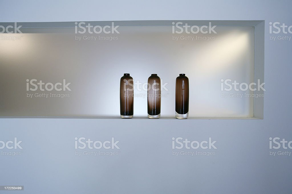 Three emtpy brown bottles on a shelf royalty-free stock photo