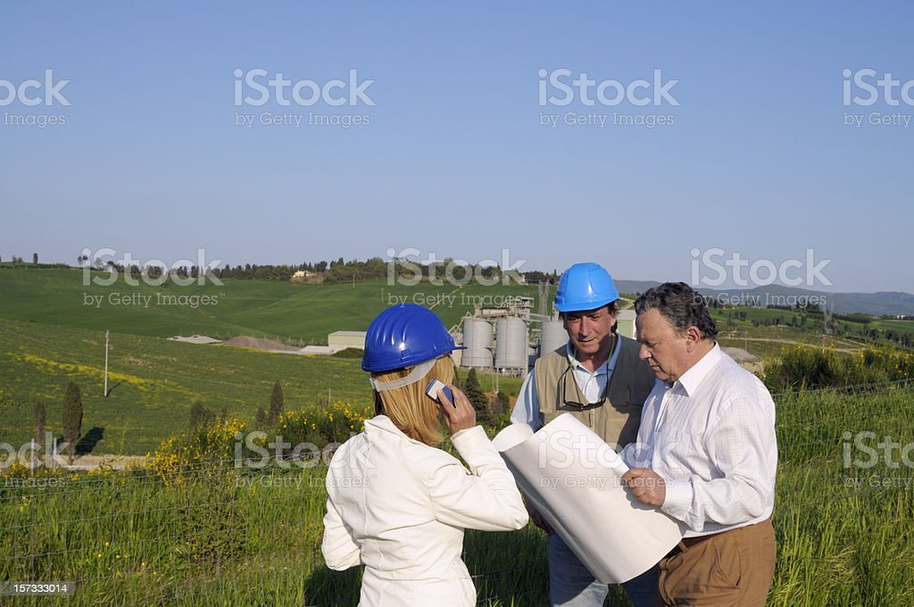 Three Engineers Planning in a Green Field royalty-free stock photo