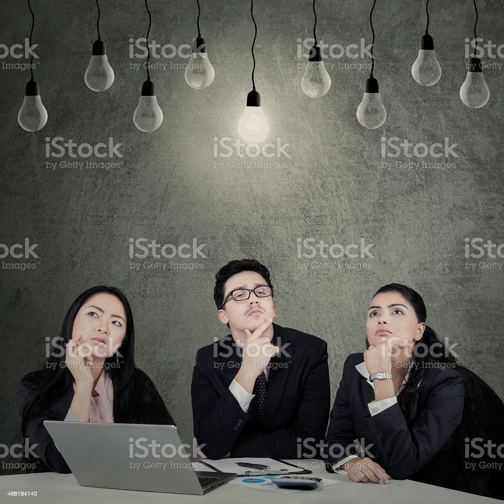 Three entrepreneurs find the solution stock photo