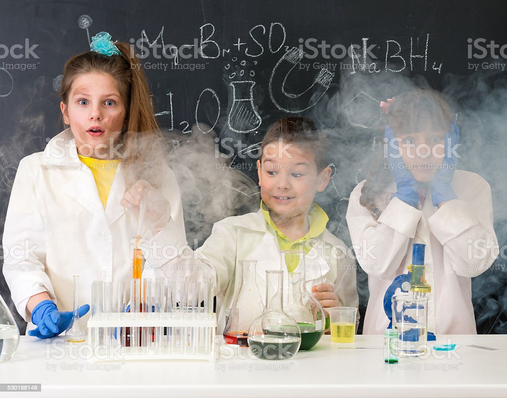 three excited children after chemical experiment stock photo