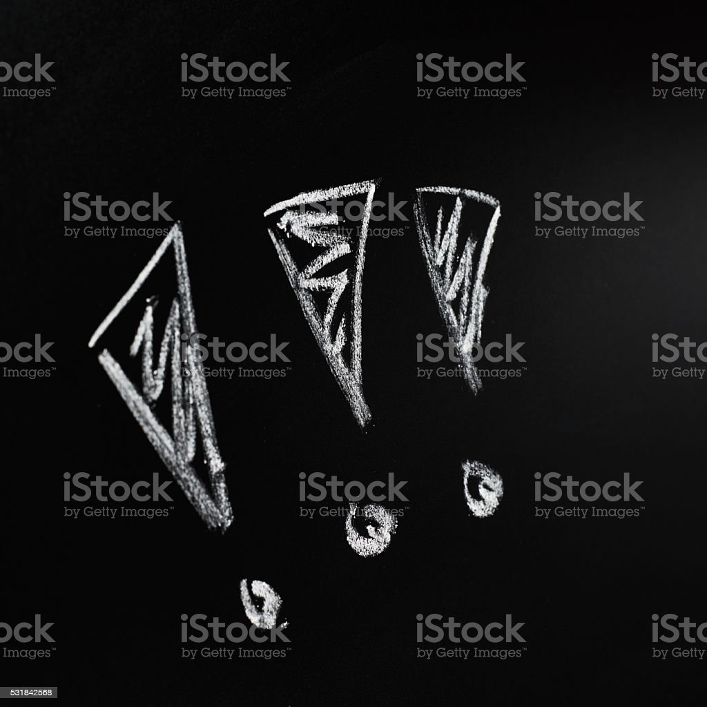 Three exclamation marks on the blackboard stock photo