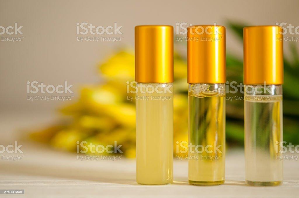 Three face serum bottles on wooden table stock photo